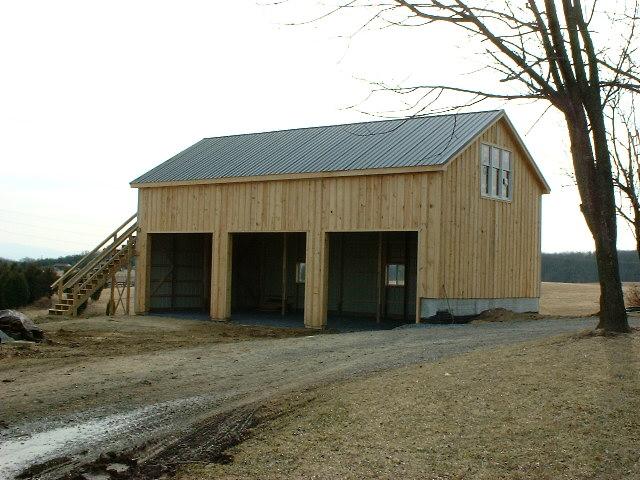 Machinery storage barns southern barns of distinction for Barn shaped garage